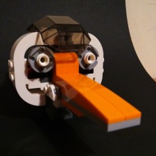 Lego model of the head of an orange-billed stork