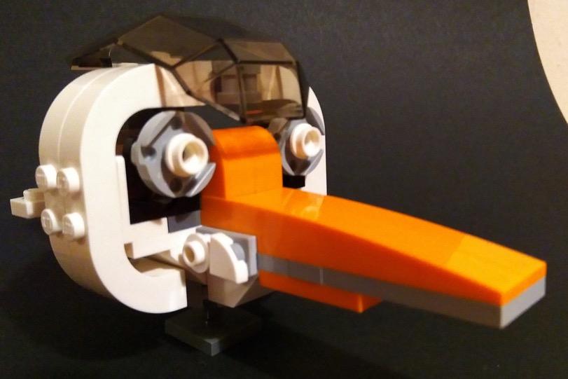 Lego model of the head of an orange-billed stork